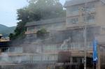 湯けむりにけぶる伊勢屋旅館:小浜温泉;クリックすると大きな写真になります